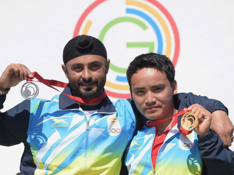 India's Jitu Rai (R) and Gurpal Singh celebrate after winning GOLD and silver medals respectively in the 50m Pistol