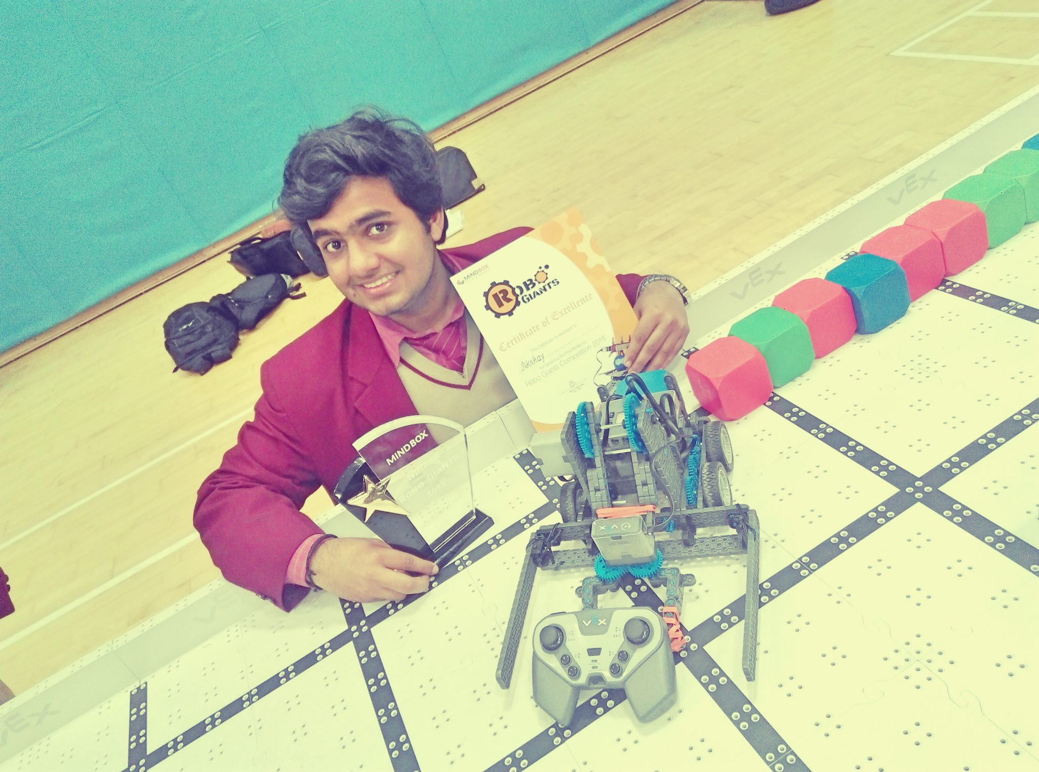 Robot that can talk and pick up object built by a 11th grader