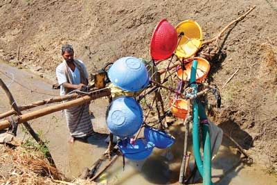 Farmer designs water mill for electricity
