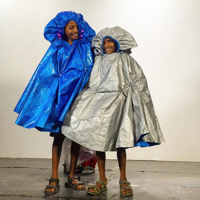 Designer teaches kids to make raincoats
