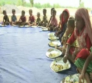 Anganwadi workers feeding tribal people