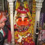 Devotees offer liquor to this deity